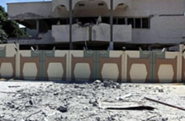 A picture taken during a government-guided tour on May 12, 2011 shows a damaged building in Bab al-Aziziya in Tripoli, following NATO air strikes on Libyan leader Moamer Gadhafi's compound