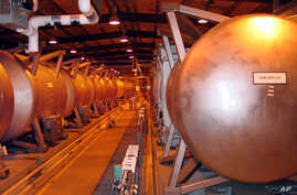 In this file photo, giant containment cylinders used to move deadly chemical weapons from storage igloos to an incinerator inside the Umatilla Chemical Weapons Disposal Facility outside Hermiston, Ore., June 8, 2004