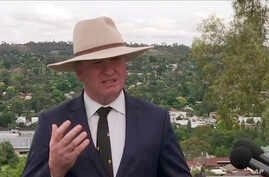 Australian Deputy Prime Minister Barnaby Joyce speaks to reporters in Tamworth, Australia, Feb. 23, 2018. Joyce said he will  resign from the Cabinet over allegations that he sexually harassed a woman.