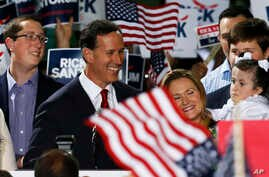 Former U.S. Sen. Rick Santorum, center, stands with his family as he announces his candidacy for the Republican nomination for president, May 27, 2015 in Cabot, Pennsylvania.