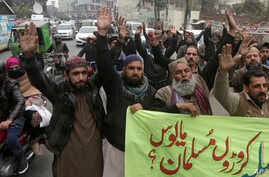 Activists from the Pakistani religious party Sunni Threek protest the Supreme Court's decision to uphold the acquittal of Aasia Bibi, in Lahore, Jan. 30, 2019.