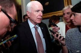 Sen. John McCain, R-Ariz., speaks with reporters before heading into a policy luncheon on Capitol Hill, Sept. 19, 2017, in Washington.