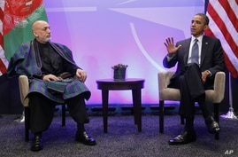 President Barack Obama, right, during his meeting with Afghan President Hamid Karzai