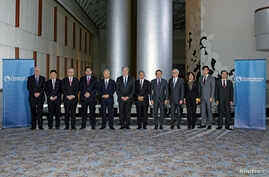 "Trade ministers from a dozen Pacific nations in Trans-Pacific Partnership Ministers meeting post in TPP Ministers ""Family Photo"" in Atlanta, Georgia, October 1, 2015."