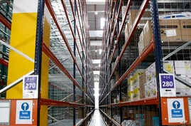 FILE - Inside view of the new Amazon warehouse located in Boves, northern France,  Oct. 3, 2017.