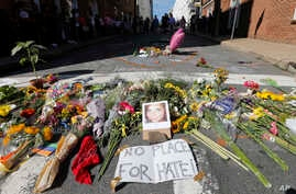 A makeshift memorial of flowers and a photo of victim, Heather Heyer, sits in Charlottesville, Virginia, Aug. 13, 2017.
