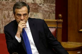 Greece's Prime Minister Antonis Samaras attends the first round of voting to elect a new Greek president at the Parliament in Athens, Dec. 17, 2014.