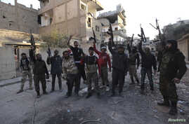 Members of the Jund Allah Brigades, part of the Free Syrian Army, hold their weapons as they pose for a photograph in Deir al-Zor, eastern Syria February 18, 2014. Picture taken February 18, 2014.