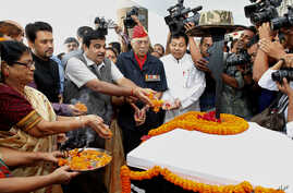 Bharatiya Janata Party  (BJP) President Nitin Gadkari pays homage to martyrs of the 1962 India-China war before that start of a commemorative journey, in Gauhati, India, Oct. 18, 2012.