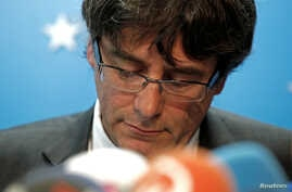 Sacked Catalan leader Carles Puigdemont attends a news conference at the Press Club Brussels Europe in Brussels, Belgium, Oct. 31, 2017.