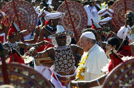 Pope Francis is greeted as he arrives at the Colombo airport, January 13, 2015.