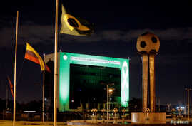 The headquarters of the South American Football Confederation (CONMEBOL) in Luque, Paraguay, is lit up in green to pay tribute to members of Chapecoense soccer team involved in the plane crash in Colombia, Nov. 30, 2016.