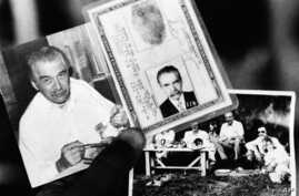 FILE - Federal police agent holds two photos and the identity card June 7, 1985 found in the house in which the man believed to be Nazi War Criminal Josef Mengele lived. Photo on left shows Mengele eating.