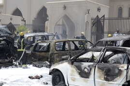 Firemen work at the site where a car exploded near a Shi'ite mosque in Dammam, Saudi Arabia, May 29, 2015.