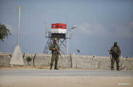 Palestinian members of security forces loyal to Hamas stand guard on the border between Egypt and southern Gaza Strip July 5, 2013. Egyptian security forces closed the Rafah border crossing and state media said it would reopen on Saturday. Security s