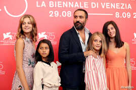 "Director Saverio Costanzo and Elisa Del Genio, Margherita Mazzucco, Ludovica Nasti and Gaia Girace attend a photo call for the film ""My Brilliant Friend"" at the Venice Film Festival, Venice, Italy, Sept. 2, 2018."