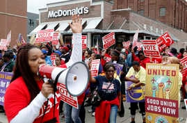 FILE - Protesters rally in front of a McDonald's restaurant, Oct. 2, 2018, in Detroit, calling for higher pay and the right to form unions in Michigan.