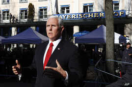 United States Vice President Mike Pence briefs the media during the Munich Security Conference in Munich, Germany, Saturday, Feb. 16, 2019.