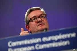 EU Commissioner for Security Union Julian King talks to journalists during a joint news conference with EU Commissioner for Digital Economy Mariya Gabriel at the European Commission headquarters in Brussels, Tuesday, Jan. 29, 2019.