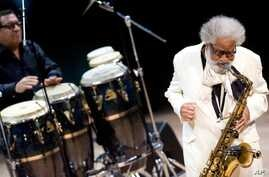 American tenor saxophonist Sonny Rollins, right, performs with drummer Sammy Figueroa in Budapest, Hungary, Nov. 10, 2011. The Jazz Foundation of America honored Rollins with a lifetime achievement award Oct. 22, 2015.