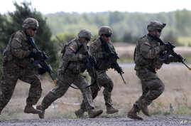 Members of the U.S. Army's 173rd Airborne Brigade practice during the combined Lithuanian-U.S. training exercise at the Gaiziunai Training Area, west of Vilnius, Lithuania, July 7, 2015.