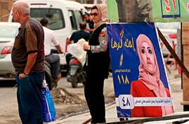 A poster of a woman candidate for parliamentary elections is seen at a bus stop in Baghdad, Iraq, April 22, 2018.