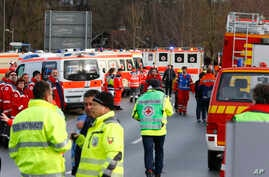 Rescue personnel wait in Bad Aibling, Germany after two regional trains crashed, killing at least two people, Feb. 9, 2016.