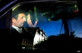 FILE - Former Iranian president Mahmoud Ahmadinejad waves from his car outside his house in northeastern Tehran, Iran, Aug. 3, 2015.