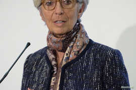 Managing Director of the International Monetary Fund Christine Lagarde speaks at a press conference at the Treasury in London, Dec. 11, 2015.