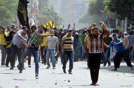 Supporters of deposed President Mohamed Mursi and the Muslim Brotherhood clash with anti-Mursi protesters during a march in Cairo, Oct. 4, 2013.