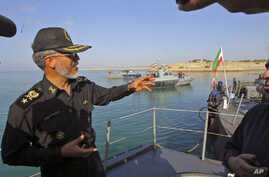 Iran's top naval officer, Admiral Habibollah Sayyari gestures as he speaks during the Velayat-90 war game on the Sea of Oman near the Strait of Hormuz, in southern Iran, December 28, 2011.