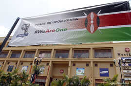 A banner promoting peace hangs outside the Westgate shopping mall during the first anniversary memorial service of the Westgate terrorist attack in Kenya's capital Nairobi, Sept. 21, 2014.