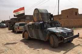 Iraqi security forces are seen on patrol after pushing Islamic State militants out of Fallujah, Iraq, June 26, 2016.