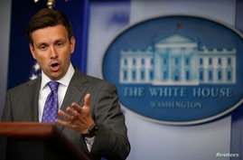 FILE - White House Press Secretary Josh Earnest speaks to media during the daily briefing at the White House in Washington.