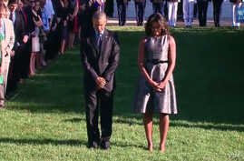 U.S. President Barack Obama, first lady Michelle Obama and White House staff hold moment of silence at 8:45 a.m. in honor of 9/11 attack victims, Sept. 11, 2015.