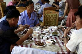 Food served on a table during lunch time at Pyongyang House of Sweet Meat, a restaurant specialized in dishes made of dog meat, in Pyongyang, North Korea, July 25, 2018.