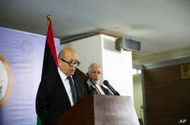 French Minister of Foreign Affairs Jean-Yves Le Drian, left, with the Libyan Minister of Foreign Affairs Mohammed Siala during a press conference after meeting with the President of the Council Faiz Al-Sarraj in, Tripoli, Sept. 4, 2017.