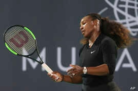 Serena Williams, of the U.S., reacts in an exhibition match against Jelena Ostapenko, of Latvia, during the final day of the Mubadala World Tennis Championship in Abu Dhabi, United Arab Emirates, Dec. 30, 2017.
