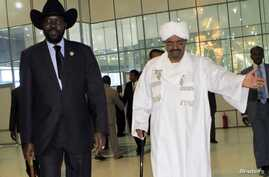 Sudan's President Omar al-Bashir welcomes his South Sudanese counterpart Salva Kiir during his arrival at Khartoum Airport October 8,2011.
