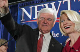 Republican presidential candidate and former House Speaker Newt Gingrich waves to the crowd with his wife Callista during a South Carolina Republican presidential primary night rally, Jan. 21, 2012, in Columbia, S.C.
