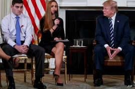 From left, Marjory Stoneman Douglas High School student Jonathan Blank, Julia Cordover, the student body president at Marjory Stoneman Douglas High School, President Donald Trump, participate in a listening session with high school students, teachers