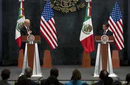 U.S. Vice President Joe Biden puts his hand to his chest as he tells Mexican President Enrique Pena Nieto that U.S. campaign rhetoric about Mexico and immigrants does not represent the view of most Americans, in Mexico City, Feb. 25, 2016.