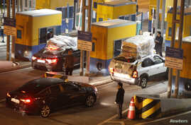 South Korean vehicles return from the inter-Korean Kaesong Industrial Complex in North Korea to the Customs, Immigration and Quarantine office in the South, just south of the demilitarized zone separating the two Koreas in Paju, north of Seoul, April