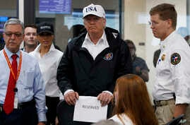President Donald Trump and first lady Melania Trump participate in a tour of the Texas Department of Public Safety Emergency Operations Center, Aug. 29, 2017, in Austin, Texas.