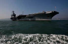 """The aircraft carrier USS Carl Vinson is anchored in Hong Kong water, Dec. 27, 2011. The carrier currently is headed towards the Korean Peninsula as a """"prudent measure."""""""