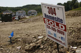Construction is underway at a housing development in Zelienople, Pennsylvania, Sep. 10, 2014.