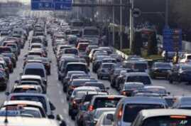 Beijing Limits Car Ownership to Ease Road Congestion