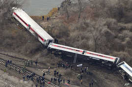 Emergency rescue personnel work the scene of a Metro-North passenger train derailment in the Bronx borough of New York, Dec. 1, 2013.