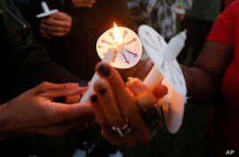 Supporters light candles during a vigil for 15-year-old Jordan Edwards in Balch Springs, Texas, May 4, 2017. Edwards was killed leaving an unruly house party Saturday night when former police officer Roy Oliver opened fired on the car Edwards was a p