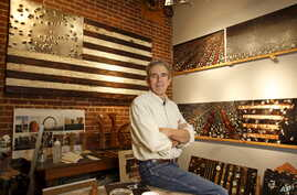 Thomas Sayre, the great grandson of U.S. President Woodrow Wilson, poses for a photograph in his studio near some of his artwork creations in Raleigh, North Carolina, December 1, 2015.  Photo taken December 1, 2015.